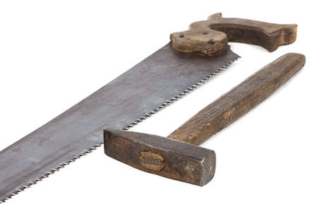 Image of handsaw and hammer on white background photo