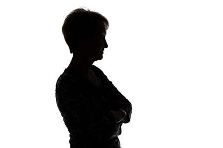 Silhouette of adult woman in profile on white background