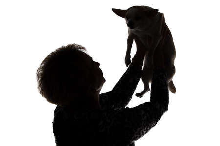 Silhouette of a woman with the dog on white background photo