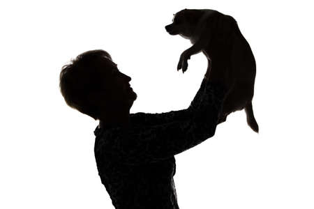 Photo of a womans silhouette with the dog on white background photo