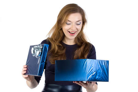 Photo of surprised woman received the gift on white background photo