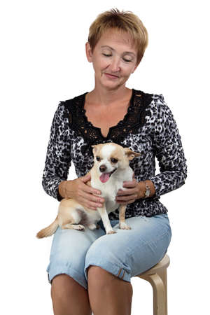 Photo of the sitting old woman with the dog on white background photo