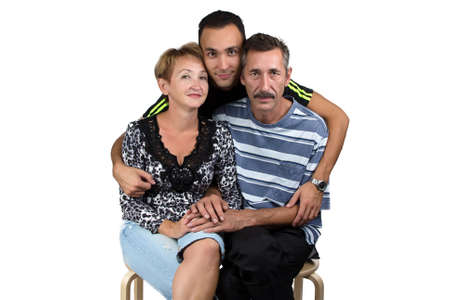 Photo of the hugging happy family on white background Stock Photo