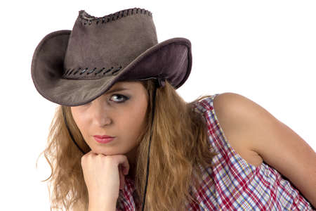 Photo of young cowgirl on white background photo