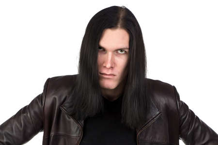Portrait of angry informal man with long hair on white background Stock Photo
