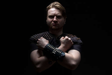 Image of the man with arms crossed on black background photo