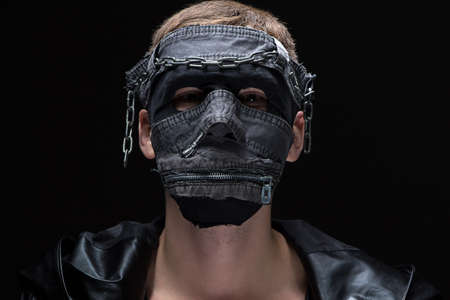madman: Photo of madman in handmade mask on black background