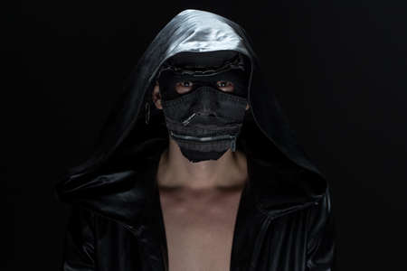 madman: Photo of the madman in handmade mask on black background