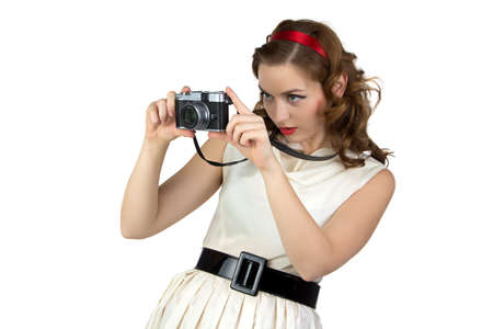 Photo of the woman with camera on white background photo