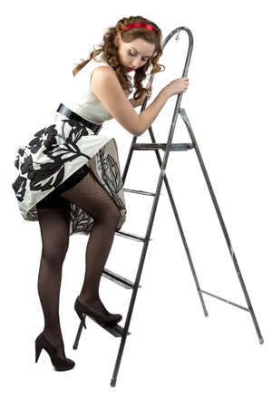 discomfiture: pin up woman down the stairs on white background Stock Photo