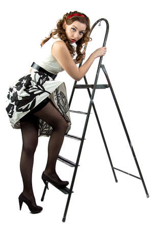 discomfiture: Image pin up woman down the stairs on white background
