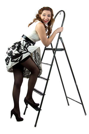 discomfiture: Portrait pin up woman down the stairs on white background