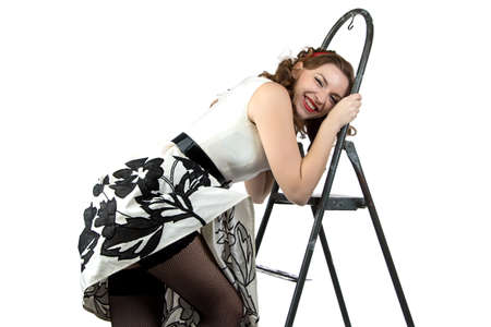 discomfiture: Photo smiling pin up woman down the stairs on white background