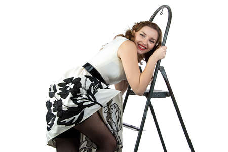 discomfiture: Image smiling pin up woman down the stairs on white background