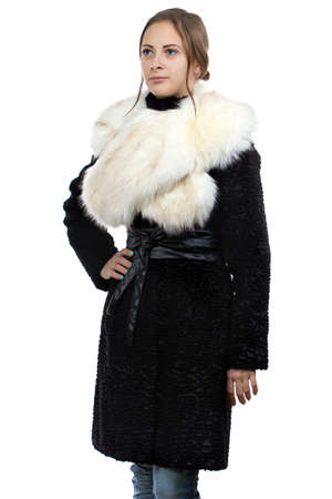 Photo of the young woman in fur coat on white background photo