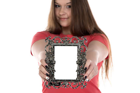 Photo of teenage girl showing photo frame on white background