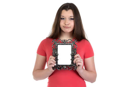 boring frame: Image of sad teenage girl with photo frame on white background Stock Photo