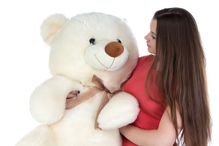blessedness: Photo of girl looking at teddy bear on white background