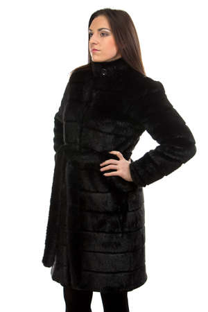 fur coat: Image of the brunette in fur coat on white background