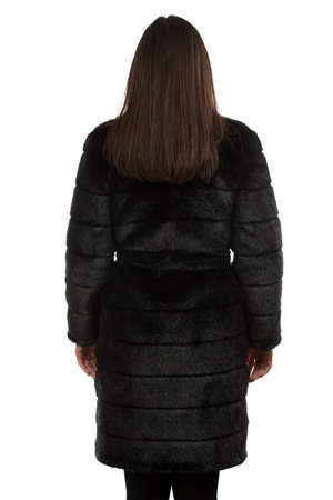manteau de fourrure: Image of the brunette in fur coat from the back on white background