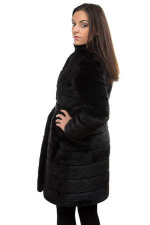 fur coat: Portrait of the brunette in fur coat on white background
