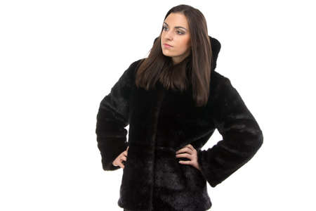 manteau de fourrure: Portrait of the serious woman in fur coat on white background