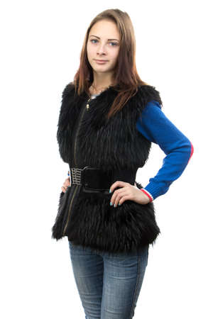 Photo of the young woman in fur waistcoat on white background photo