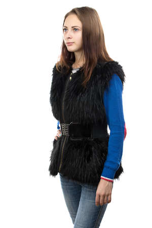 Portrait of the young woman in fur waistcoat on white background photo