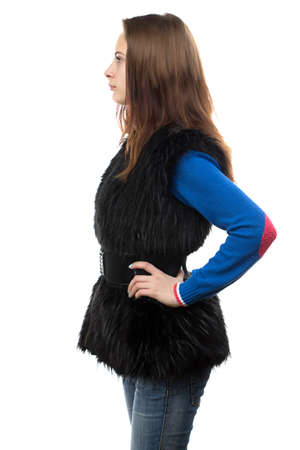 Photo of the young woman in fur waistcoat - profile on white background photo