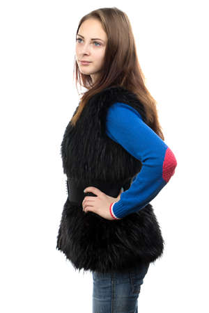 Photo of the young woman in fake fur waistcoat on white background photo