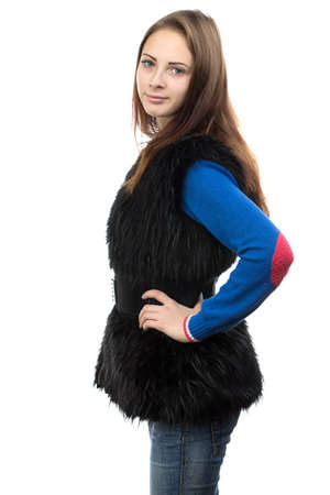 Image of the young woman in fake fur waistcoat on white background photo