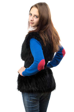 Image of the young woman in fake fur waistcoat from the back on white background photo