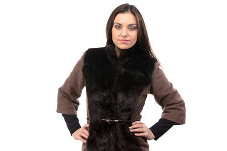 Photo of woman in brown fur waistcoat on white background photo
