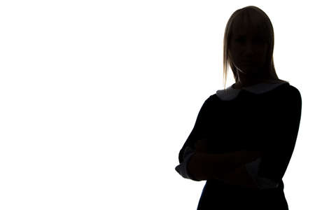 Silhouette of woman with arms crossed on white background, half-turned Stock Photo