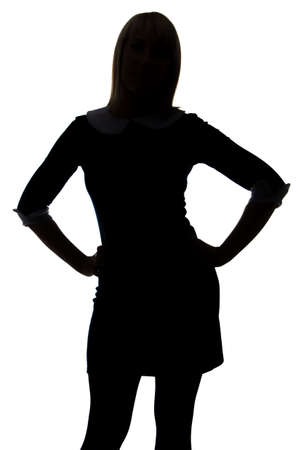 Silhouette of woman with hands on hip on white background
