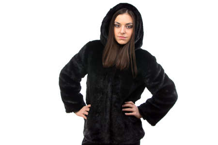 woman in fur coat: Photo of woman in black fur coat with hood on white background
