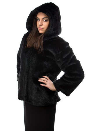 woman in fur coat: Photo of serious woman in fur coat with hood on white background Stock Photo