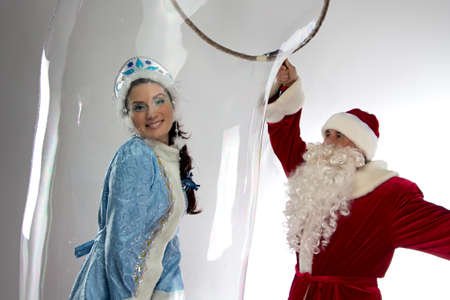 ded moroz: Image of snow girl in soap bubble and Santa Claus