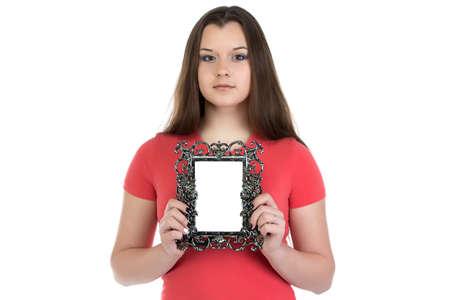 boring frame: Portrait of teenage girl holding photo frame on white background Stock Photo