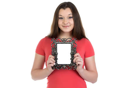 boring frame: Photo of smiling teenage girl with photo frame on white background Stock Photo