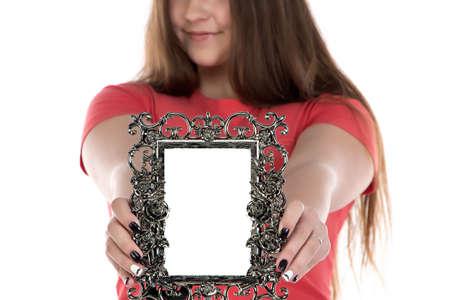 boring frame: Image of teenage girl showing photo frame on white background
