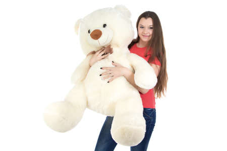 blessedness: Teenage girl with white teddy bear on white background