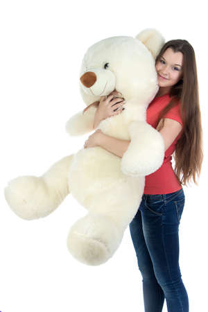 blessedness: Standing teenage girl with teddy bear on white background