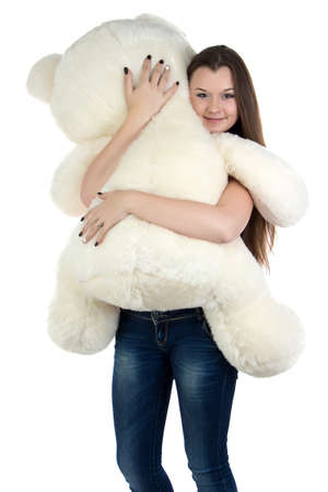 blessedness: Standing teenage girl with white teddy bear on white background