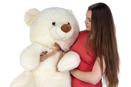 blessedness: Image of girl looking at teddy bear on white background