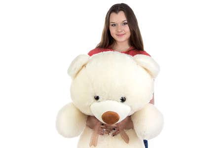 blessedness: Teenage girl holding teddy bear on white background