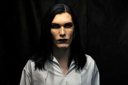 Image of mans make up on black background photo