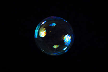 Image of colour soap bubble on black background