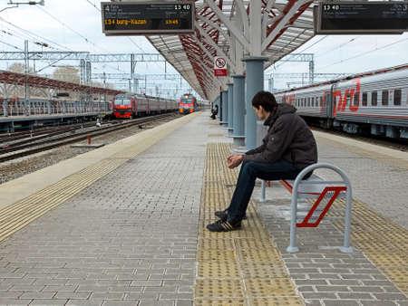 stoop: Photo of man waiting the train on platform in Kazan, Russia