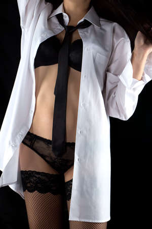 bra and panties: Photo of woman in mens shirt and lingerie on black background Stock Photo